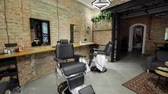 radersi : interior of a Barber shop with a beautiful design. Modern chair with levers in hair salon.