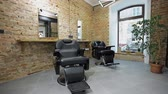 barbear : interior of a Barber shop with a beautiful design. Modern chair with levers in hair salon.