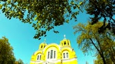 Panoramic shooting of a beautiful yellow church in the park of Kiev Stock Footage
