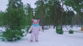 Little girl walking in the forest in winter