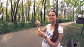 若い : Young pregnant woman playing with soap bubbles in the park, Kiev, Ukraine 動画素材