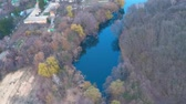 郊外の : Flying over the monastery near the river in the forest