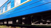 Blue train rides left at the foot of the Carpathian mountains