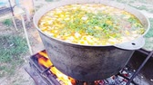 Bograch. Soup with paprika, meat, bean, vegetable, dumpling. Traditional Hungarian Goulash in cauldron. Meal cooked outdoors on an open fire. Delicious and healthy food popular in Central Europe