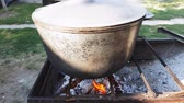 paprika : Bograch. Soup with paprika, meat, bean, vegetable, dumpling. Traditional Hungarian Goulash in cauldron. Meal cooked outdoors on an open fire. Delicious and healthy food popular in Central Europe
