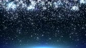 Abstract slow falling snowflakes on blue background and light from bottom. Stock Footage