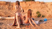 girl : the mother and the two girls on the beach, a woman makes massage Stock Footage