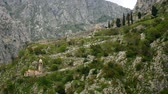 ortodoxo : Church Gospa od Zdravlja of Kotor on the wall, Montenegro, Kotor Bay, the Balkans, the Adriatic Sea. Stock Footage