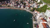 estância turística : Settlement Rafailovici, Budva Riviera, Montenegro. The coast of the city on the Adriatic Sea. Aerial photography. Boats at sea, hotels, villas and apartments on the coast.