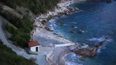 adriatic sea : The beach Crvena Glavica in Montenegro. Wild beach, with a rocky coast. Aerial photography. Stock Footage