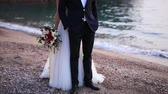 новобрачный : Newlyweds on the beach. The queens beach in the villa is a milocher, near the shone of the stephan. Wedding in Montenegro.