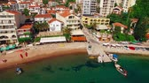 Черногория : Settlement Rafailovici, Budva Riviera, Montenegro. The coast of the city on the Adriatic Sea. Aerial photography. Boats at sea, hotels, villas and apartments on the coast.
