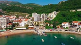 czerwiec : Settlement Rafailovici, Budva Riviera, Montenegro. The coast of the city on the Adriatic Sea. Aerial photography. Boats at sea, hotels, villas and apartments on the coast.