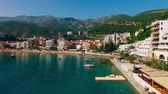adriatic sea : Settlement Rafailovici, Budva Riviera, Montenegro. The coast of the city on the Adriatic Sea. Aerial photography. Boats at sea, hotels, villas and apartments on the coast.