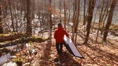 watercraft : Tourist carries the kayak to the water in the forest in Montenegro
