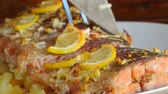 bazylia : Baked salmon with pineapple and slices of lemon on a plate on a wooden background. Wideo