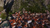 torre : The Old Town of Kotor. Flying over the city. Aerial survey by a drone. Montenegro Stock Footage