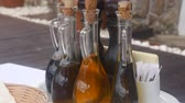zeytinyağı : Bottles with seasonings in a fishing cafe in Montenegro. Cork stoppers, glass body. Stok Video