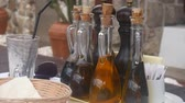 zastawa stołowa : Bottles with seasonings in a fishing cafe in Montenegro. Cork stoppers, glass body. Wideo