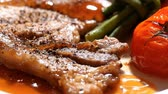pieprz : Pork chop steak serve with vegetable in restaurant Wideo