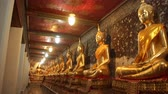 reclináveis : Row Of Buddhist Statues in temple Stock Footage