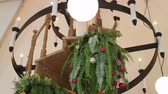 украшать : Christmas ball and hanging fern decorated in living room Стоковые видеозаписи