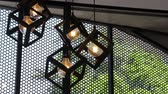 Design hanging light bulbs in coffee shop, stock footage Vídeos