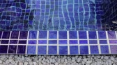 граница : Blue clay square tiles border of simple swimming pool, stock footage Стоковые видеозаписи