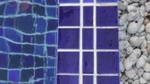Blue clay square tiles edges of swimming pool, stock footage