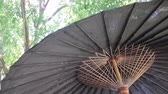 Weathered outdoor umbrella in the garden, stock footage