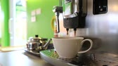 steel : Automatic coffee machine pouring espresso in cup extremely