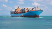 exportação : Miami, Fl, USA - APRIL 13, 2017: Large cargo ship Adrian Maersk from Maersk Line with many shipping containers sailing to port Miami Stock Footage