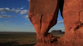 Teardrop Arch, Monument Valley - A beautiful time-lapse landscape of Teardrop Arch Monument Valley. Stock Footage