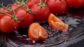 diet : Slices of Ripe Tomato Falls on the Table, Splashing Drops. Slow Motion.