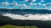 back lit : Misty Morning in the Mountains. Fog and Cloud Mountain Valley Landscape. Timelapse.