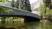 ponte : 4K Time lapse footage with tilt up motion of people rafting under the bridge across Merced River in Yosemite National Park