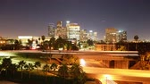 commute : 4K Time Lapse of LA Skyline over Freeway Bridge at Night -Tilt Up-