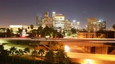 ponte : 4K Time Lapse of LA Skyline over Freeway Bridge at Night Zoom In