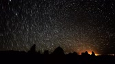 radial : Astrophotography Time Lapse of Star Trails over Tufa Towers Stock Footage