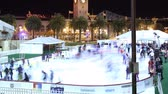 clock : Time Lapse of Ice Skate Rink at San Francisco Waterfront on Holidays Zoom Out