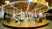 família : Time Lapse of Merry Go Round at Night Tilt Up Stock Footage