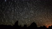 astro photography : 4K Astrophotography Time Lapse of Star Trails over Tufa Towers Pan Right