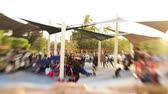 неузнаваемый : Tilt shift time lapse of kids playground at a park