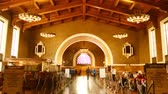 negócio : Time Lapse footage with zoom in motion of commuters in the historic hallway at Union Station in Los Angeles, California USA Stock Footage
