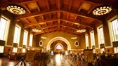 4K time Lapse footage with tilt up motion of commuters in the historic hallway at Union Station in Los Angeles, California USA Stock Footage