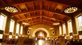 social worker : 4K time Lapse footage with tilt down motion of commuters in the historic hallway at Union Station in Los Angeles, California USA Stock Footage