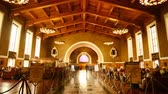 social worker : 4K time Lapse footage with zoom in motion of commuters in the historic hallway at Union Station in Los Angeles, California USA