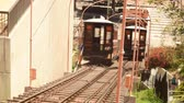 Time lapse footage with zoom out motion of historic railroad Angels Flight in downtown Los Angeles in the daytime