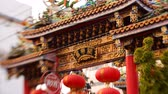elaborate : Tilt shift time lapse footage with pan right motion of Chinese temple in Yokohama Chinatown in Japan