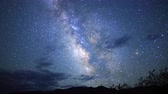 takımyıldız : 3 axis motion controlled astrophotography time lapse footage with dolly down, tilt down, pan right  zoom out motion of Milky Way galaxy over desert landscape through dawn in Death Valley National Park, California